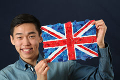Young Asian student showing UK national flag Royalty Free Stock Photography
