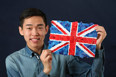 Young Asian student showing UK national flag Royalty Free Stock Image