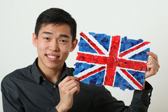 Young Asian student showing UK national flag Stock Photo