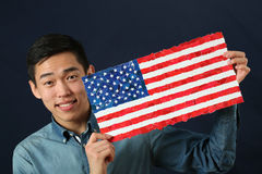 Young Asian student showing US national flag Royalty Free Stock Photography