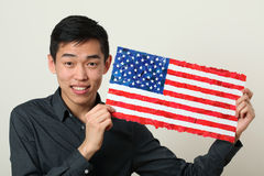 Young Asian student showing US national flag Stock Images