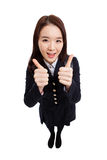 Young Asian student shwing thumbs isolated on white background. Stock Photos