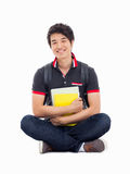 Young Asian student sitting floor. Stock Photo