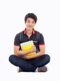 Young Asian student sitting floor. Royalty Free Stock Photos