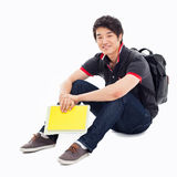 Young Asian student sitting floor. Royalty Free Stock Image