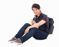 Young Asian student sitting floor. Royalty Free Stock Photography