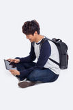 Young Asian student using pad PC Stock Images