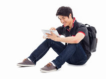 Young Asian student using pad PC. Isolated on white background Royalty Free Stock Images