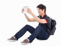 Young Asian student using pad PC. Isolated on white background Royalty Free Stock Image