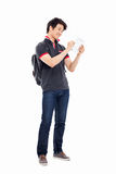 Young Asian student using pad PC. Isolated on white background Royalty Free Stock Photos