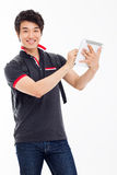 Young Asian student using pad PC Stock Photo
