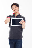 Young Asian student using pad PC Royalty Free Stock Photo