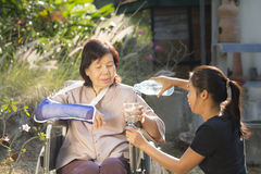 Young asian taking care the senior woman Royalty Free Stock Photography