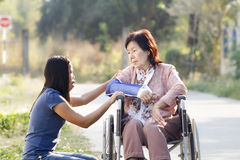 Young asian is taking care the senior woman stock images