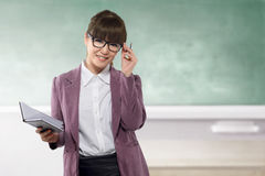 Young asian teacher with book on class royalty free stock photography