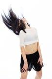 Young Asian teen flinging hair Royalty Free Stock Image