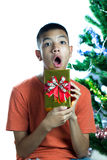 Young asian teen surprise on Christmas present Royalty Free Stock Images