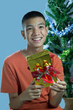 Young asian teenager happy to get a gift Royalty Free Stock Photos