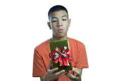 Young asian teenager wondering what in the box Royalty Free Stock Photo