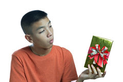 Young asian teenager wondering what in the box Stock Images
