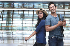 Young asian tourist couple going traveling Stock Photos
