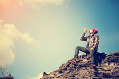 Young asian tourist drinking water Royalty Free Stock Image