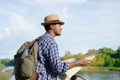 Young Asian tourist man with backpack Stock Images