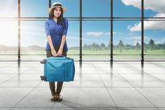 Young asian tourist woman with luggage standing. On terminal airport Stock Photo