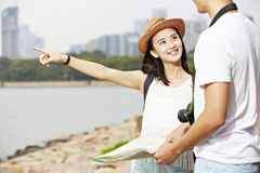 Young asian tourists on the road stock image