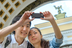 Young asian tourists taking pictures Stock Photo
