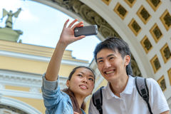 Young asian tourists taking pictures Royalty Free Stock Images