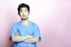 Young Asian Trainee Doctor wearing Scrubs Royalty Free Stock Images