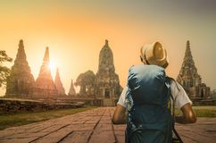 Young asian traveler with backpack in temple Ayuttaya, Thailand royalty free stock photography