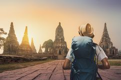 Young asian traveler with backpack in temple Ayuttaya, Thailand royalty free stock photo