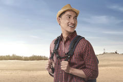Young asian traveler wearing a hat with backpack. On the sand dune Stock Photos