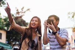 Young Asian travelers taking photo of city royalty free stock photography