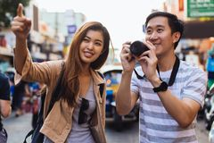 Young Asian travelers taking photo of city stock photography