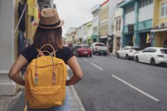 Young Asian traveling backpacker in Khaosan Road outdoor market in Bangkok, Thailand, Tourist, Travel and backpack concept. stock image