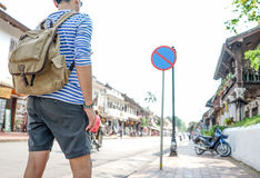 Young Asian traveling backpacker in Street old town Royalty Free Stock Images