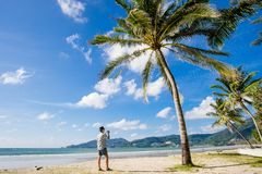 Young Asian traveling at Patong beach, Phuket, Thailand stock images