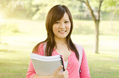 Young Asian university girl student Stock Images