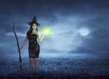 Young asian witch with broom and magic spell Stock Image