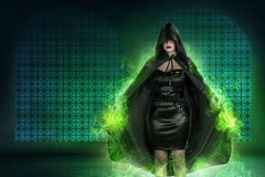 Young asian witch woman with green fog background. In empty room stock images