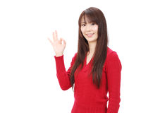 Young asian woman. With ok gesture Stock Photo