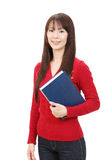 Young asian woman. Portrait of young asian woman holding book Royalty Free Stock Photo