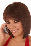 Young Asian woman. Enjoying a phone conversation Stock Photo
