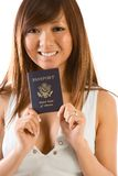 Young Asian woman with American passport in hand Royalty Free Stock Image