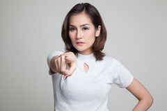 Young Asian woman angry and point to camera. Royalty Free Stock Photo