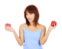 Young asian woman with an apple and a piece of donut Stock Image