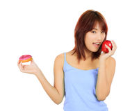 Young asian woman with an apple and a piece of donut Royalty Free Stock Photography